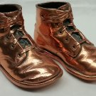 Bronze or copper coated bronzed baby shoes