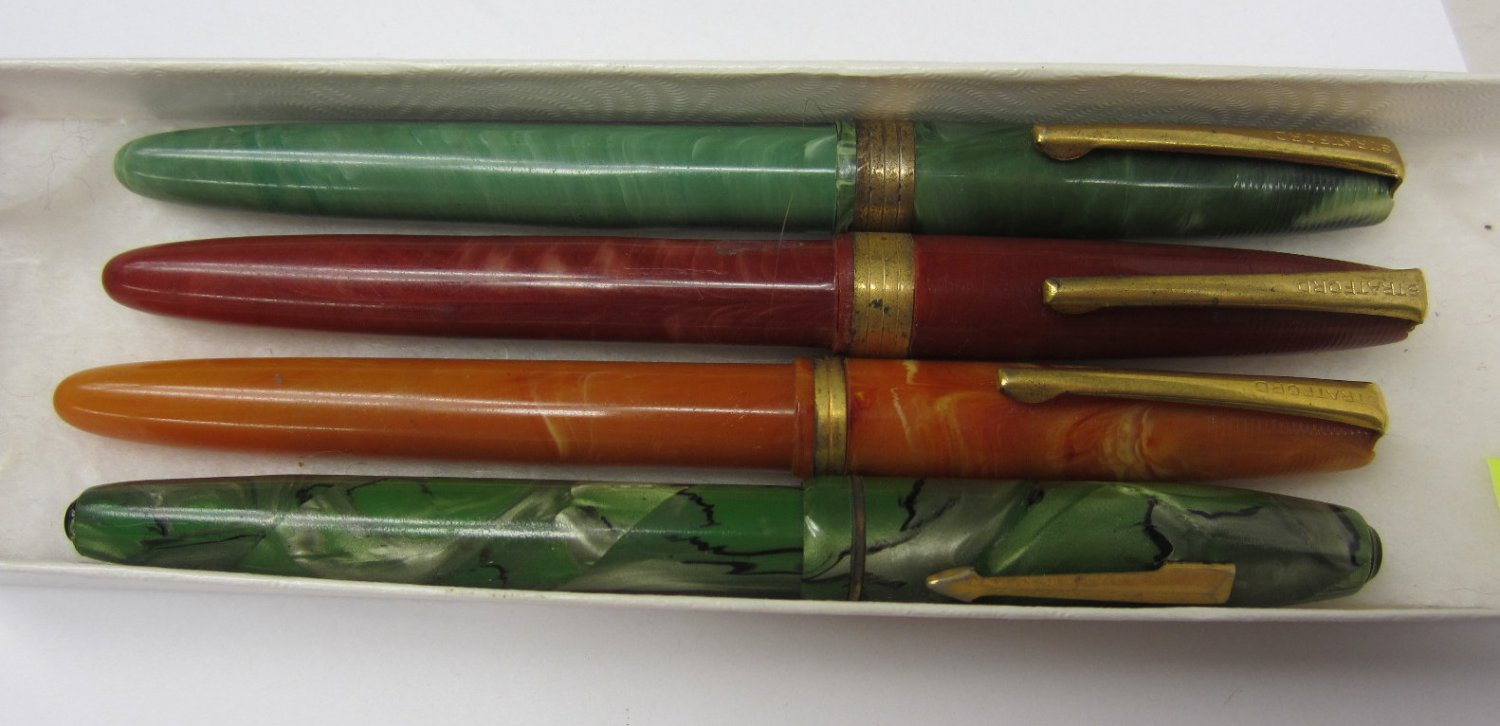 Four fountain pens for parts