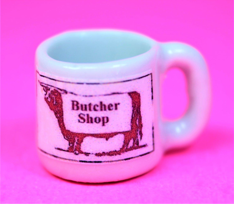 Dollhouse size replica of souvenir butcher coffee mug