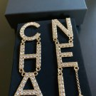 CHANEL Gold Crystal Letters 2019 RUNWAY Statement Dangle Earrings NIB