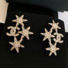 CHANEL CC CRYSTAL STAR Silver Stars Stud Earrings Hallmark Authentic NIB