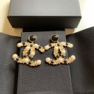 CHANEL CC Gold Metal Resin Pearl Crystal Black stones Dangle Earrings