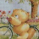 Teddy bear with bike cross stitch pattern in pdf DMC