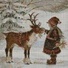 Little girl with reindeer cross stitch pattern in pdf DMC