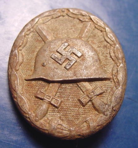 WWII German military Nazi wound badge vintage pin L/56 hollow back award steel swastika helmet medal