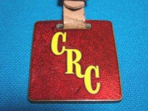 Crutcher Rolfs Cummings CRC Houston pocket watch fob vintage advertising enamel brass 1930s