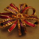 Weighted Yellow Rhinestone Clear Purple And Red Enamel GoldTone Metal Bow Brooch