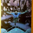Wolverine Logan Jumping from building Marvel Comics Poster by John Cassady