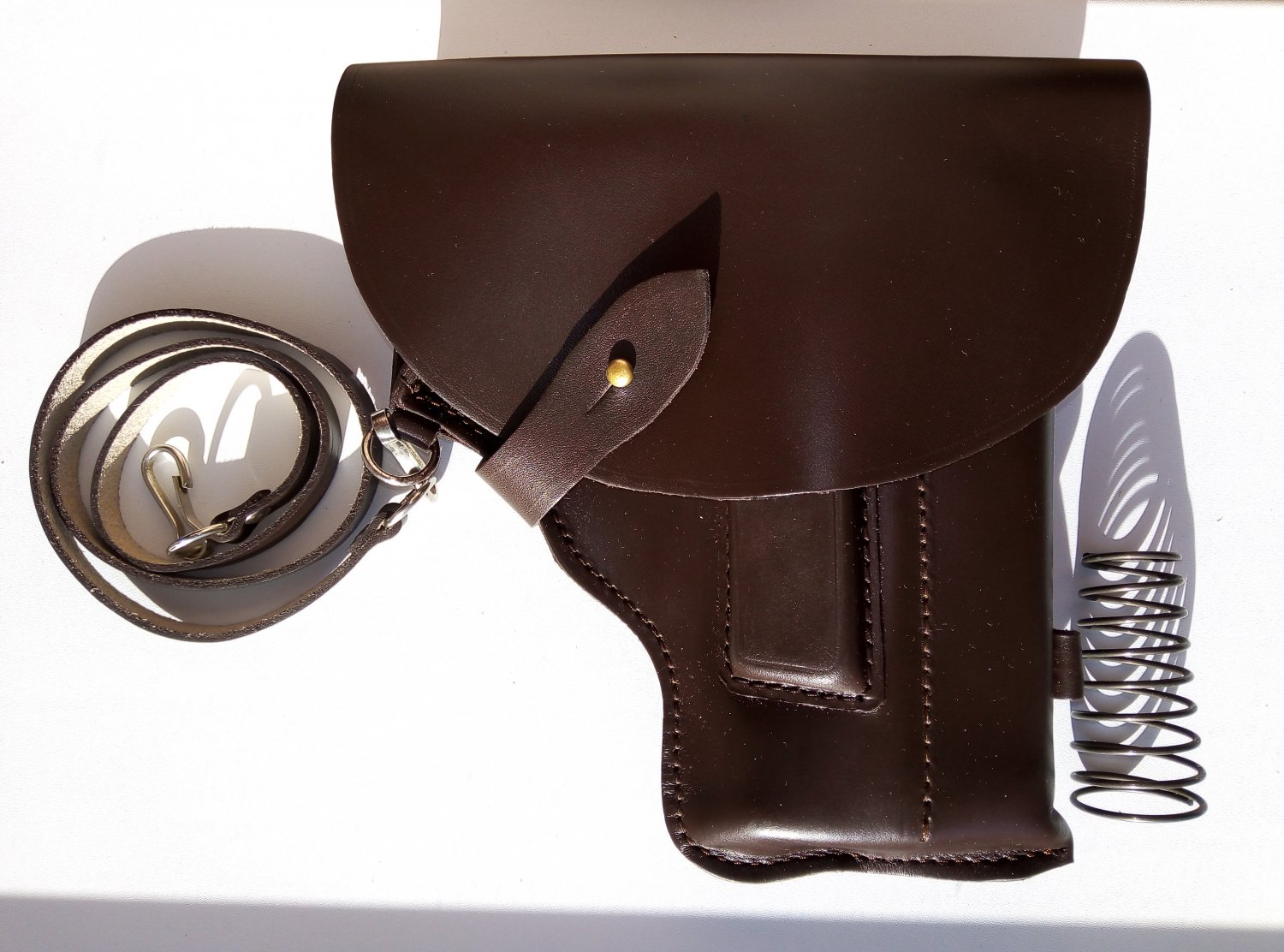 MP-654K holster leather parts Baikal with convenient compartment for the cylindrical nozzle.