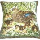 Mallard duck with eight fluffy golden ducklings by the river edge cushion