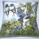 bright blue and white Swallows on a summer day cushion