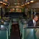 """President Barack Obama Sits on a Seat in the """"Rosa Parks Bus""""  Poster 12x19 inches"""