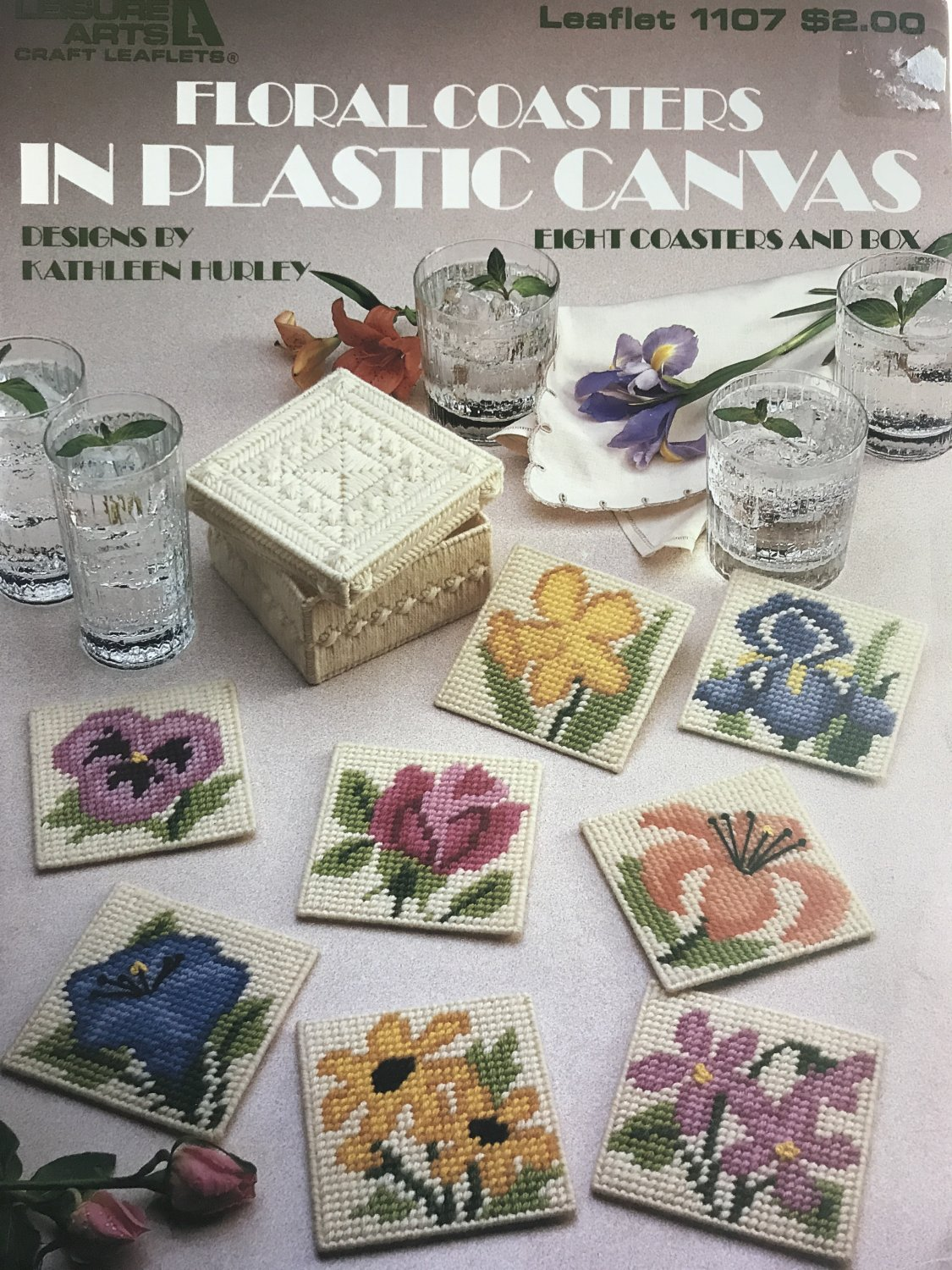 Floral Coasters in Plastic Canvas Leisure Arts  1107 Eight flower designs and box