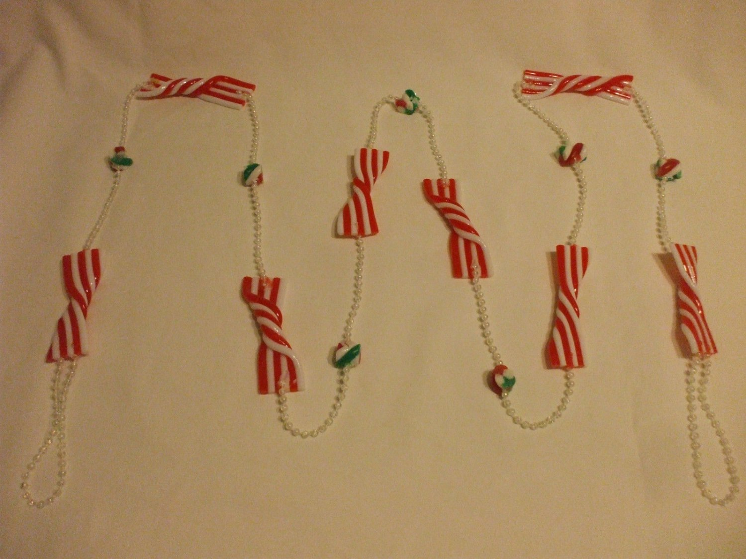 Red And White And Green Plastic Christmas Bows 72 Inches Long