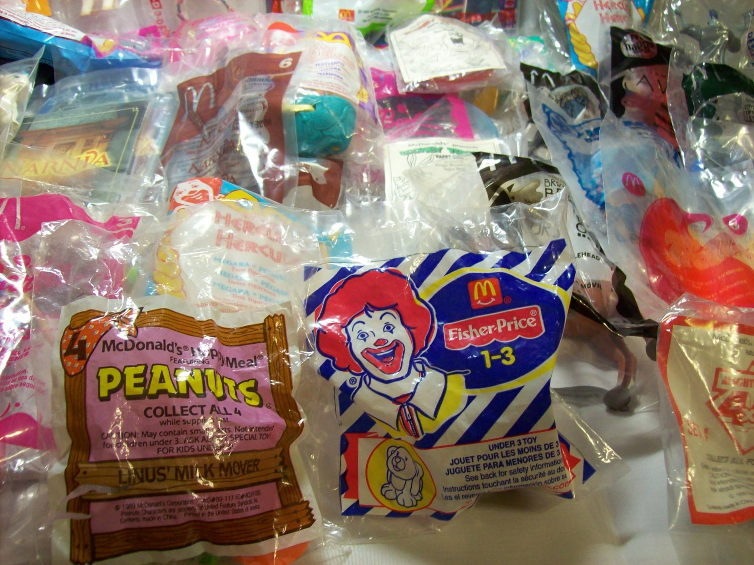 McDonald's Happy Meal Toys; Lot of 5 to 6 Toys from Various Years and Type.