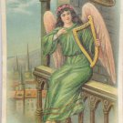 Antique Easter Postcard Angel wearing Green with Pink Wings Playing Harp