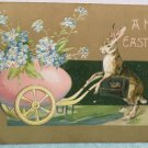 1908 Easter Postcard Humanized Rabbit Pushing Egg in Carriage Embossed Posted