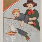 Antique Valentine Postcard Boys Sailing a Boat Divided Embossed  Unposted