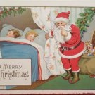 Christmas postcard Santa Claus children sleeping embossed Unposted Divided