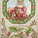 Antique Christmas Postcard Santa Claus Getting Toys Out Of Bag Embossed Posted
