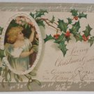 Antique Christmas Postcard Little Girl and Holly Posted Undivided