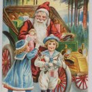 Antique Christmas postcard Santa Claus Driving a Car Giving Girls Presents