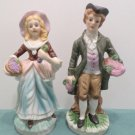 Antique figurines Bisque Man and a Woman with Baskets of Grapes