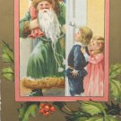 Antique Christmas Postcard Santa Claus Dressed in Green Embossed Posted Germany