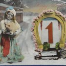 Antique New Year Postcard Girl by Horseshoe Glossy Divided and Posted 1911