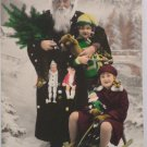 Antique Christmas Postcard Santa Claus Dressed in Black Holding Child France