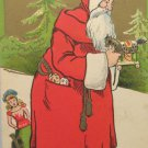 Antique 1911 Christmas Postcard Santa Claus Fixing a Toy Divided Posted