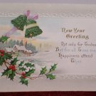 Antique 1913 New Year Postcard Holly Bells Posted Divided Embossed