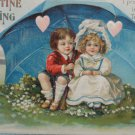 Antique Valentine Postcard Girl and Boy on Swing Embossed Divided Unposted