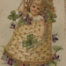 Antique Birthday Postcard Little Girl in a Basket Embossed Unposted