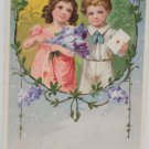 Antique Postcard Little Girl and Boy Gemany Glossy Posted Divided