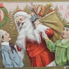 Antique Christmas Postcard Santa Claus With Toys and Two Boys