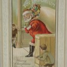 Christmas Postcard Santa Claus boys hold string try to trip Santa Posted Divided