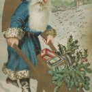 Christmas Postcard Santa Claus Wearing Blue Robe Pushing Wheelbarrow Unposted