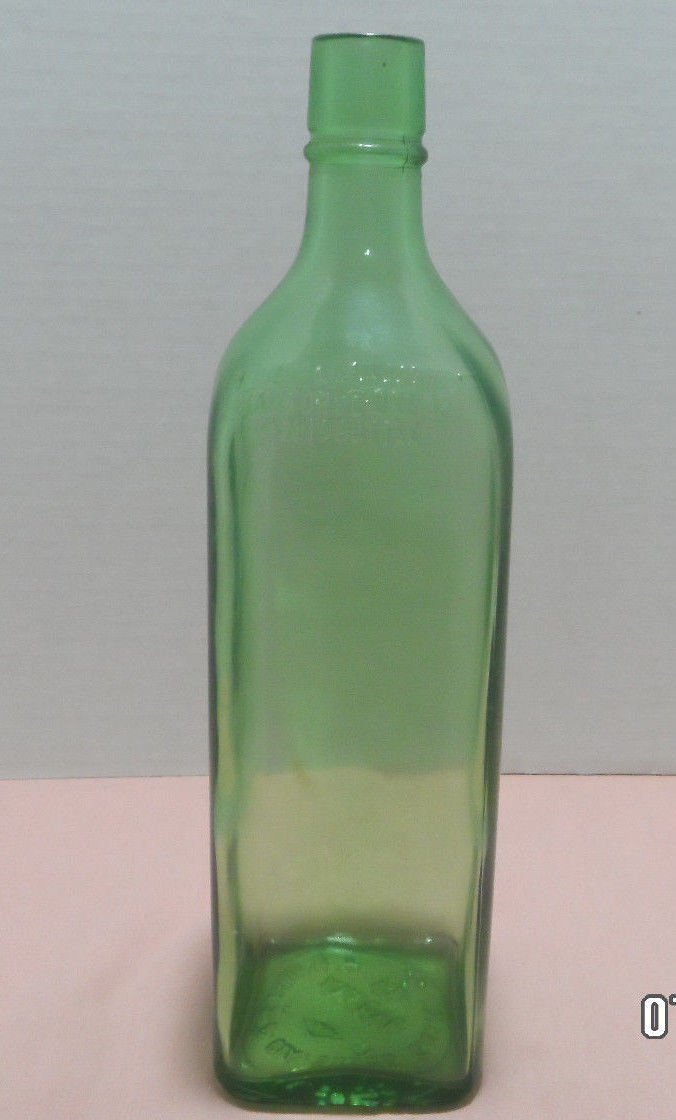 "Saurs Liquor Bottle Green Glass Square 10 1/2"" Tall J R Nieves and CIA."