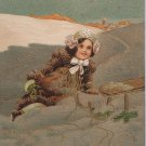 Antique Christmas postcard little girl Germany embossed unposted
