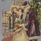 Antique Christmas Postcard Santa Claus Wearing Purple Embossed Divided Posted