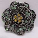 Silver Tone Metal Brooch Pin with Green and Gold Rhinestones