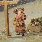 Christmas postcard Santa Claus Looking at Road Sign glossy unposted divided