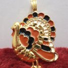 Gold Tone Turkey Necklace Pendant With Red and Black Enamel Feathers
