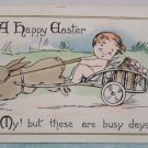 1915 Easter Postcard Rabbit Pulling Wagon of Eggs Baby Posted Divided
