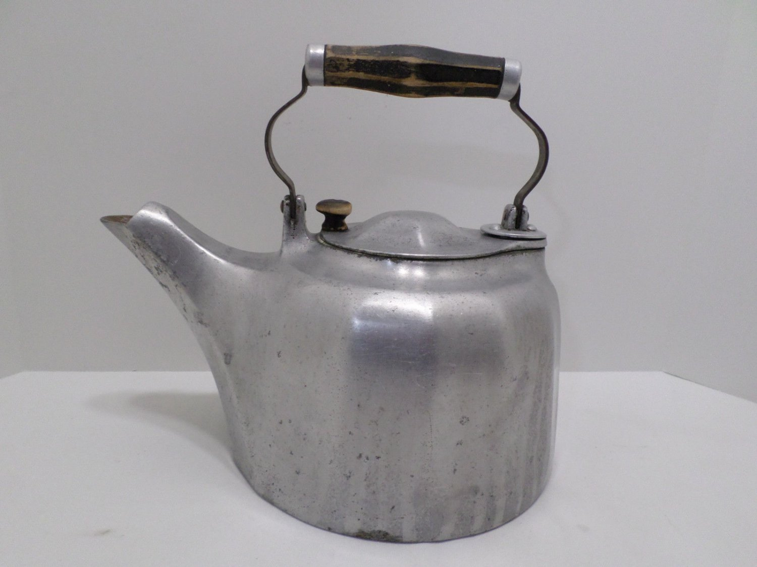 Vintage Metal Teapot with a Wooden Handle