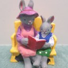 Easter Village Cast Iron Figurine Rabbits Sitting on a Bench