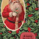 Antique Christmas Postcard Santa Claus Holding a Joker Glossy Embossed Unposted