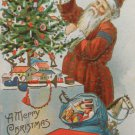 Antique Christmas Postcard Santa Claus Fixing a Christmas Tree Embossed Posted