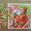 Antique Christmas Postcard Santa Claus Talking on Telephone Posted 1909